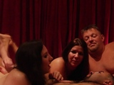 Red orgy room filled with swingers