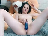 Brunette DinaSpice masturbates and fucks her pussy with a rubber phallus