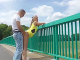Couple on motorway bridge