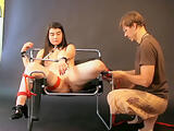 18 year old Jade get bound to a bondage chair during a photo shoot. bts vid
