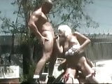 Young Layla serve two guys on scrap yard