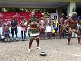 Busty African girl and fat guy doing some sort of show