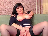 Mature brunette Aamal fucks her pussy with fist