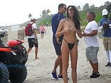 Topless buying food at the beach