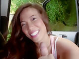 Asian beauty stroking cock in the car