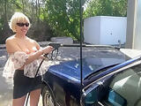 Beautiful blonde publicly plays with her pussy on carwash